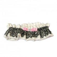 jarretière mariage bijou de soie dentelle noire et noeud rose