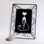 tableau chat émaillé dans cadre métal noir