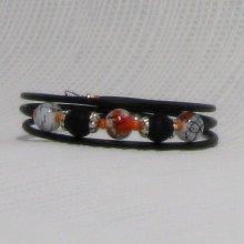 bracelet trois rangs orange et noir sur silicone noir