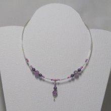 collier perles verre bicolore violet et gris sur pvc transparent
