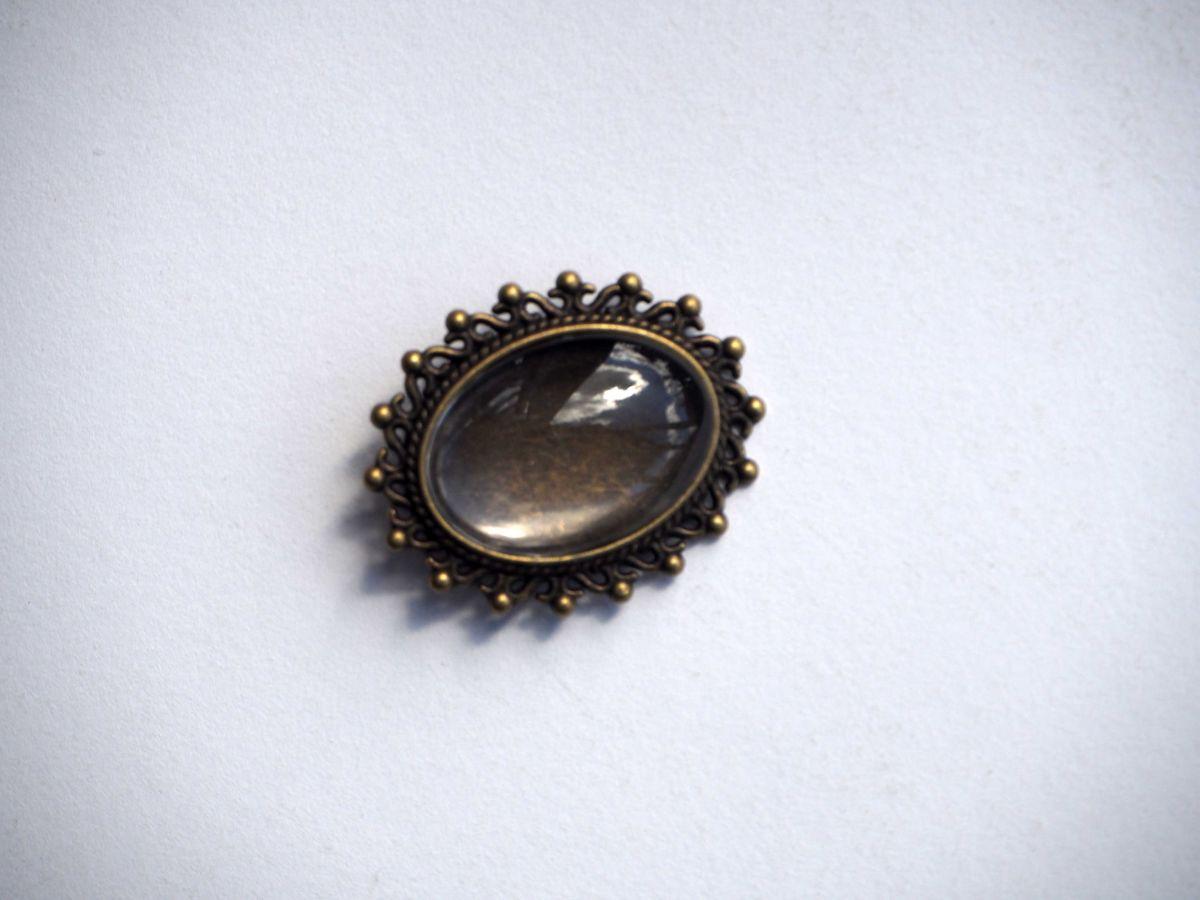 Broche épingle, cabochon ovale 25x18mm, bronze antique avec ornements