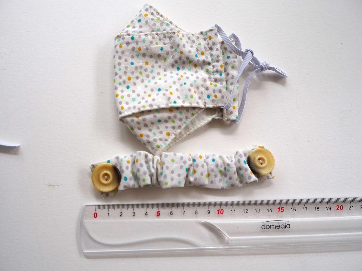 Economiseur d'oreilles, 15cm non étiré, blanc avec petits pois