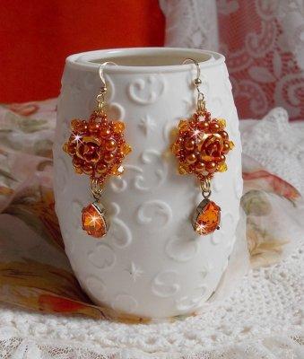 Boucle d'oreilles Lady in Orange crées en Crystal de Swarovski, rocailles et perles orangées.