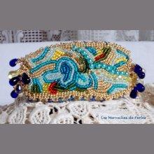 Bracelet Papillon Or Bleu brodé avecde très belles rocailles.